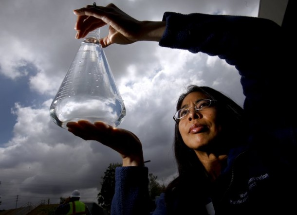 Amy Dorman, senior civil engineer with the city of San Diego's Public Utilities Department holds a sample of water purified to the quality level of pure distilled water at the Advanced Water Purification Facility in University City at the North City Water Reclamation Plant. — Howard Lipin